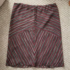 Red, black and white striped skirt